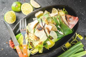 Tilapia roasted on grill in leeks