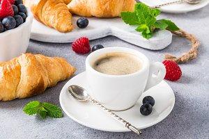 White cups of coffee and croissants