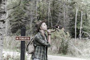 Girl with bugle hiking!
