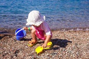 Baby play on seashore