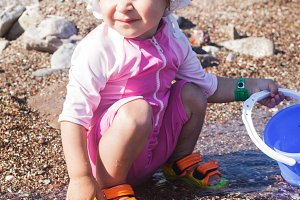 Baby play on seashore