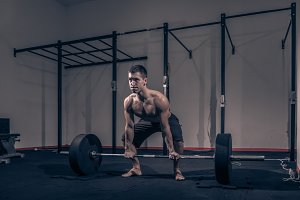bodybuilder muscular strong gym dark