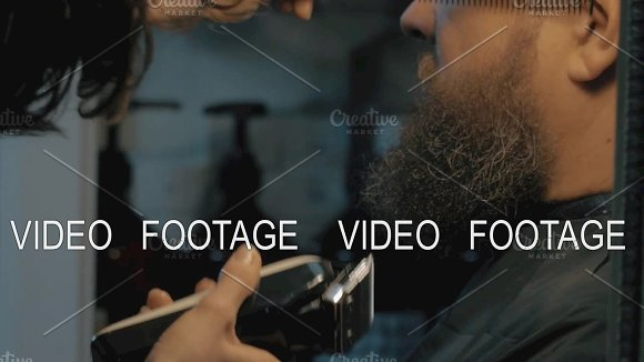 Close Up View Of Woman Hands Cares Of Beard Barber Combing And Trimming Beard