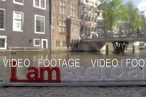 I amsterdam slogan and city view in background, Netherlands