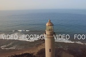 Flying over Maspalomas Lighthouse and ocean