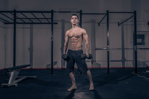 one bodybuilder muscular strong gym