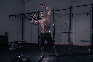 one bodybuilder muscular strong gym