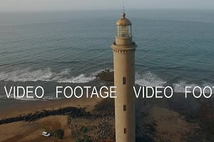 Maspalomas Lighthouse against ocean background, aerial