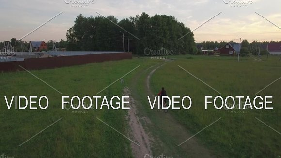 Aerial Steadicam View Of Boy Riding A Bike At Summer Russia
