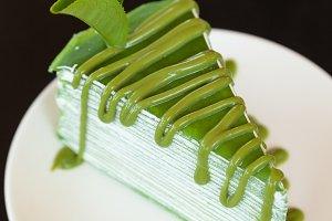 Cake matcha in dish.