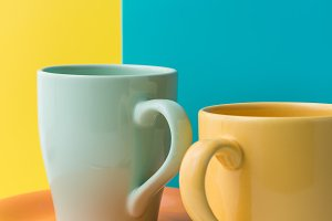 Glossy colored cups for coffee.