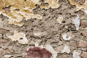 Old cracked concrete brick wall