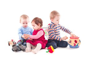 Three children play