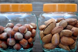Jars with hazelnuts and almonds
