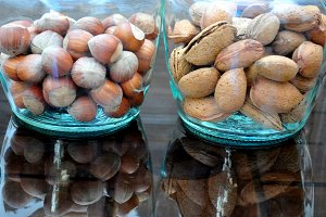 Glass jar with hazelnuts and almonds