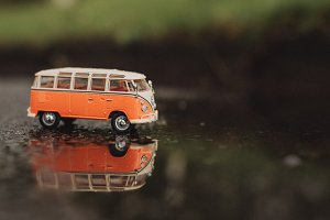 Vintage Model Bus in Puddle