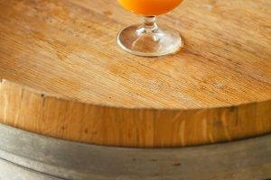 Wheat ale on a wooden barrel