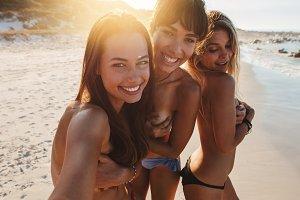 Beautiful friends taking selfie