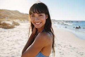 Smiling young woman in bikini