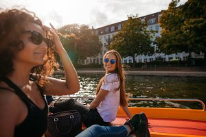 Young women on boat in lake