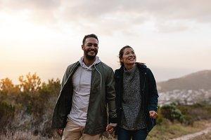 Happy hikers walking