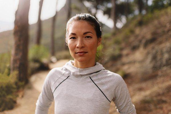 Woman runner standing outdoors