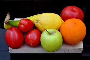 Colored fruits on wooden table
