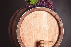 Grapes on wooden barrel