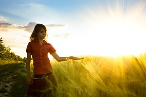 Girl on wheat fieald