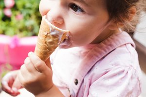 Girl eats an ice cream