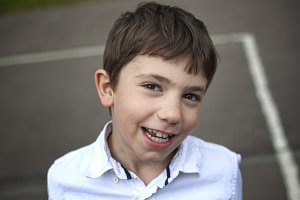 preteen smiling boy outdoor closeup portrait