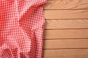 Red and white fabric on wood