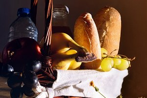 Picnic wicker basket with food dark
