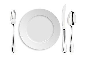 Plate with spoon, knife and fork.