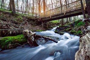 Mountain river with hiking bridge