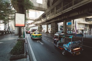 Traffic moves slowly along a busy highway road with subway MRT line above the road near the city center in Bangkok, Thailand. Cityscape photography of the capital city of Thailand - Bangkok, Asia