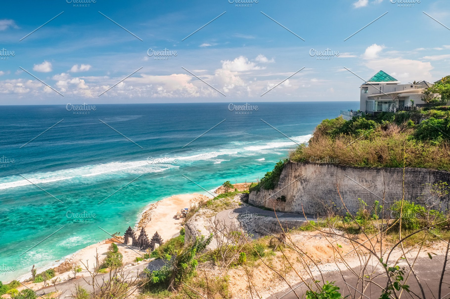Scenic landscape of high cliff on tropical white sand beach in Bali island   Indonesia tropical nature outdoor landscape with scenic sea water and