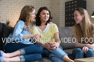 three best female friends have fun sitting at home