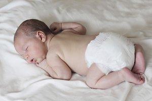 newborn sleeping with nappy