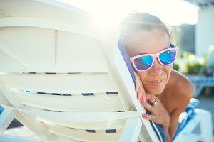 Woman lying on sunbed