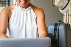 Smiling female using laptop