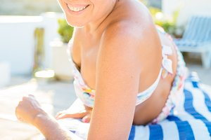 Smiling woman having rest in sunbed