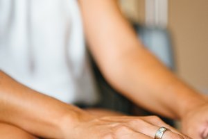 Crop shot of female using laptop