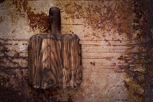 Empty cutting wooden  board On a rusty metal background. Top vie