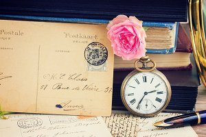 antique clock on old  books