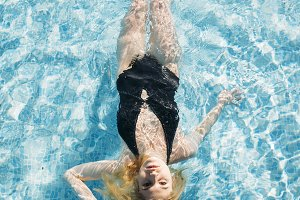 young girl lying in pool