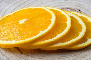 Orange slices on wooden background