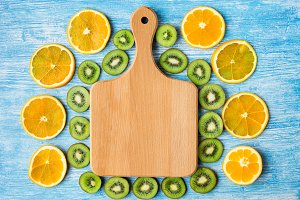 Cutting board,oranges and kiwi fruit