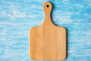 Cutting board on blue background
