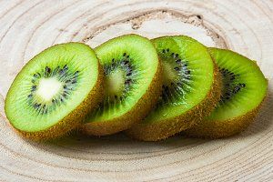 Kiwi fruit on wooden background